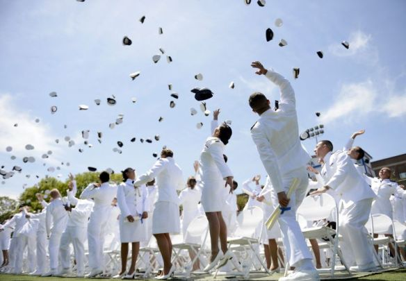 Caps are tossed into the air as newly commissioned Coast Guard ensigns divest themselves of all symbols of cadet life at the conclusion of their commencement exercises at the U.S. Coast Guard Academy, Wednesday, May 21, 2014, in New London, Conn. Homeland Security Secretary Jeh Johnson, who assumed command of the coast guard during a ceremony at the start of the exercises, delivered the commencement address to the cadets. (AP Photo/The Day, Sean D. Elliot) MANDATORY CREDIT.