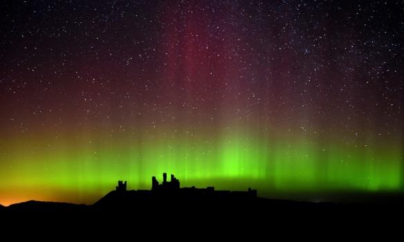 Lights over Dunstanburgh Castle in Northumberland-UK- Owen Humphrey-PA